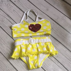 Penelope Mack yellow polka-dot bikini